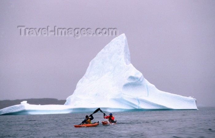 greenland89: Greenland, Sondre Stromfjod: kayakers paddeling past an iceberg - photo by S.Egeberg - (c) Travel-Images.com - Stock Photography agency - Image Bank