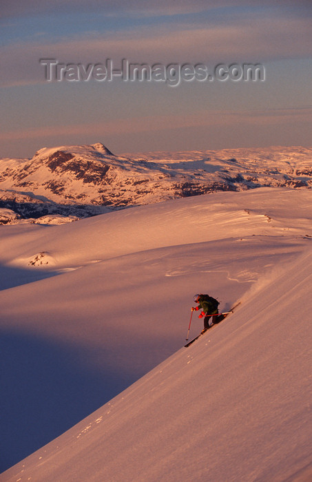 greenland90: Greenland, Apussuit: skier carving turns on steep slope at sunset - photo by S.Egeberg - (c) Travel-Images.com - Stock Photography agency - Image Bank