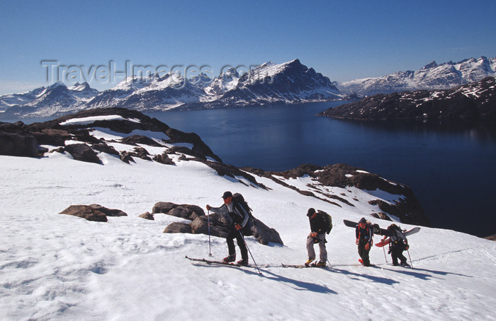 greenland91: Greenland, Apussuit: skiers climbing steep snow slope - photo by S.Egeberg - (c) Travel-Images.com - Stock Photography agency - Image Bank