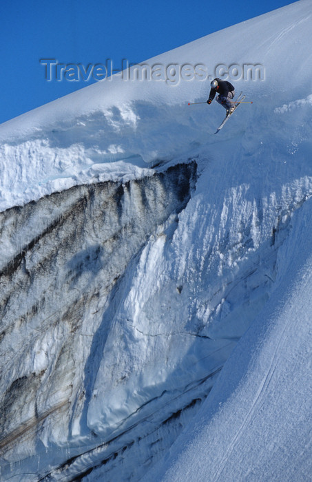 greenland95: Greenland, Apussuit: skier jumping off icewall - photo by S.Egeberg - (c) Travel-Images.com - Stock Photography agency - Image Bank