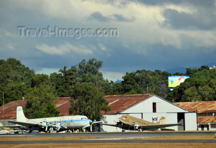 guatemala111: Ciudad de Guatemala / Guatemala city: airport - Douglas DC-4 and DC-3 - hangar and classical aircraft - photo by M.Torres - (c) Travel-Images.com - Stock Photography agency - Image Bank