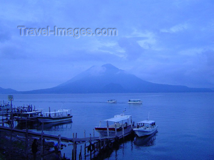 guatemala14: Guatemala - Lake Atitlan: boats, pier and volcano / Barcas y muelle en lago de Atitlan (photographer: Hector Roldán) - (c) Travel-Images.com - Stock Photography agency - Image Bank