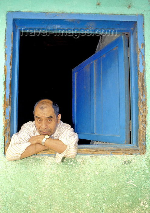 guatemala29: Guatemala - Panajachel - Lago de Atitlán - Sololá department: man in window - Lake Atitlán (photo by A.Walkinshaw) - (c) Travel-Images.com - Stock Photography agency - Image Bank