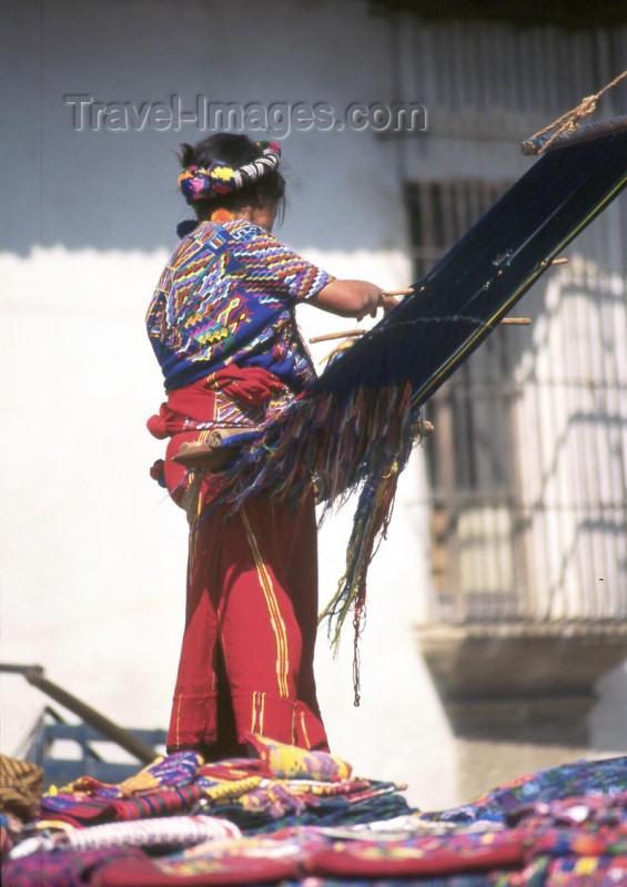 guatemala3: Guatemala - Antigua Guatemala (Sacatepequez province): woman weaving on a back strap loom (photographer: Mona Sturges) - (c) Travel-Images.com - Stock Photography agency - Image Bank