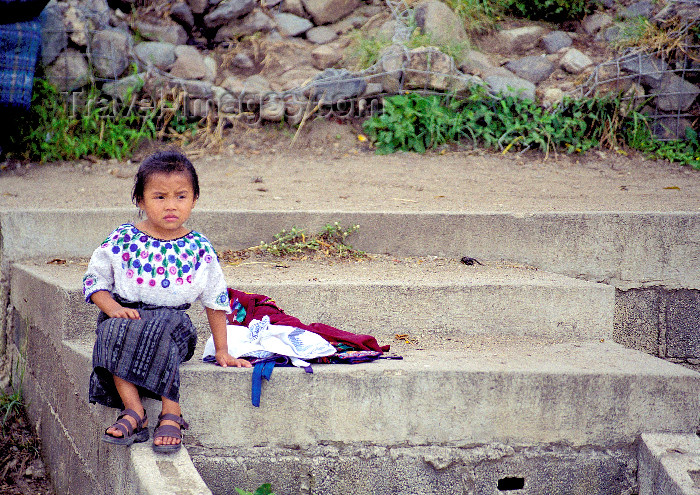 guatemala45: Guatemala - Lago de Atitlán: Lago de Atitlán: girl sitting on steps (photo by A.Walkinshaw) - (c) Travel-Images.com - Stock Photography agency - Image Bank