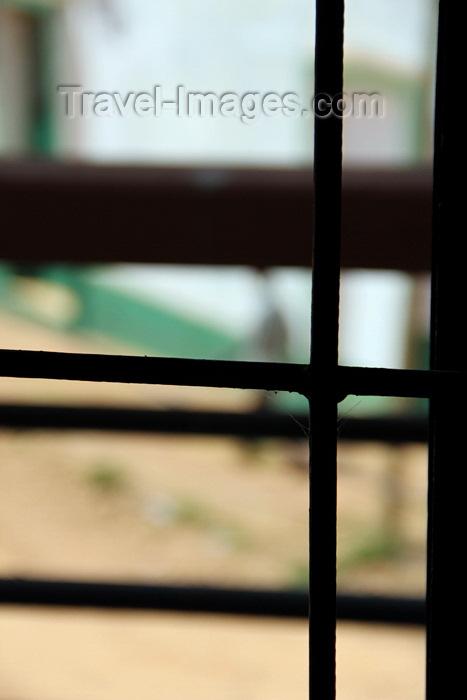 guinea-bissau198: Guinea Bissau / Guiné Bissau - Bafatá, Bafatá Region: out of focus view of an old man walking along the colonial commercial street, everyday life / voyeur, 'homem grande' a caminhar pela antiga rua comercial do período colonial português, vida quotidiana - photo by R.V.Lopes - (c) Travel-Images.com - Stock Photography agency - Image Bank