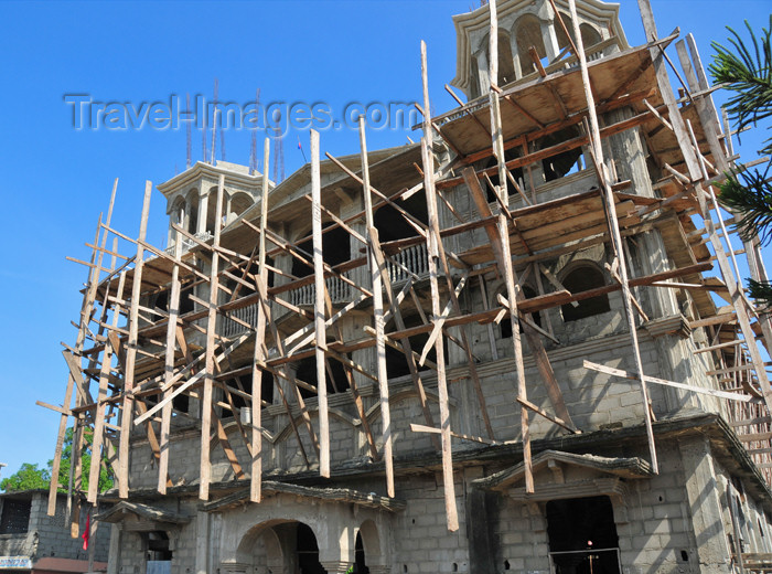 haiti51: Ouanaminthe / Juana Mendez, Nord-Est Department, Haiti: building one more church - Haiti is prolific in churches and lottery shops - photo by M.Torres - (c) Travel-Images.com - Stock Photography agency - Image Bank