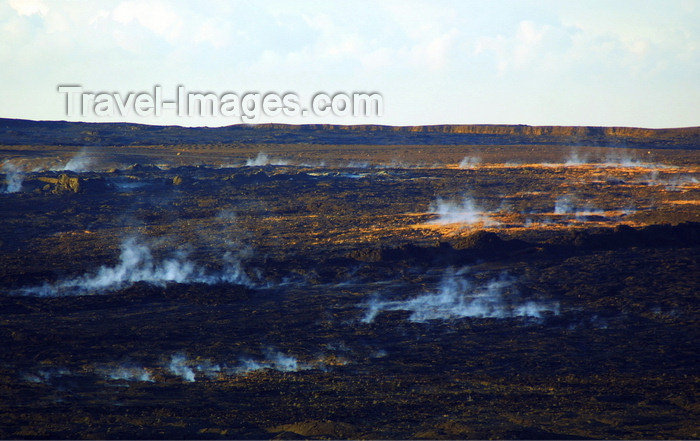 hawaii49: Hawaii island, Kilauea volcano: steam rises from hot vents on the caldera floor in the early morning - frozen lava flow - photo by R.Eime - (c) Travel-Images.com - Stock Photography agency - Image Bank