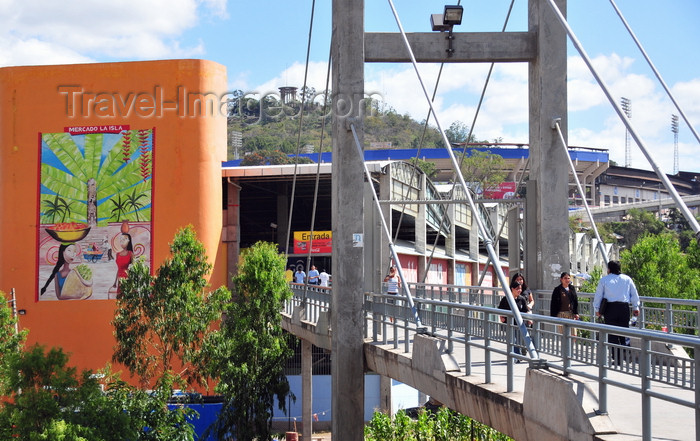 honduras53: Tegucigalpa, Honduras: bridge over Río Choluteca, leading to La Isla market - National Stadium and Peace Monument in the background - photo by M.Torres - (c) Travel-Images.com - Stock Photography agency - Image Bank