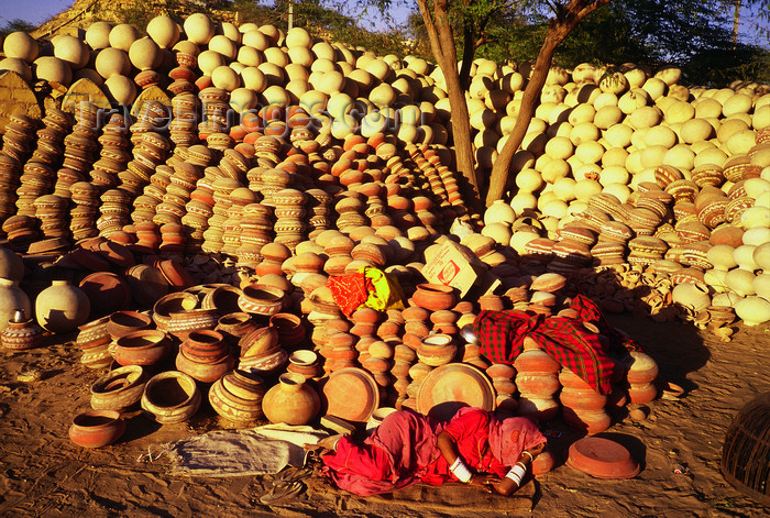 india115: India - Rajasthan: woman sleeping in a front of a stock of pottery - photo by E.Petitalot - (c) Travel-Images.com - Stock Photography agency - Image Bank