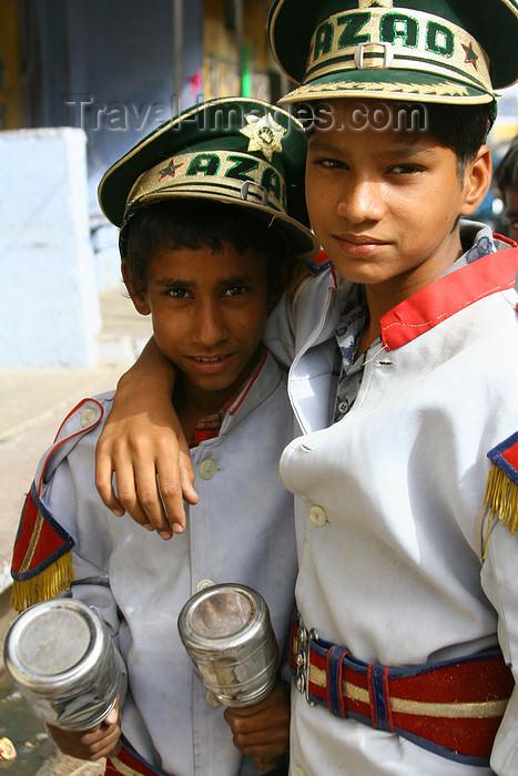 india118: Bundi, Rajasthan, India: boys with maracas and 'Azad' hats - photo by M.Wright - (c) Travel-Images.com - Stock Photography agency - Image Bank