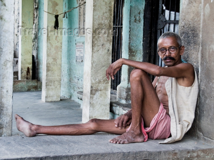india199: Varanasi, Uttar Pradesh, India: thin man sits outside a house - photo by J.Hernández - (c) Travel-Images.com - Stock Photography agency - Image Bank