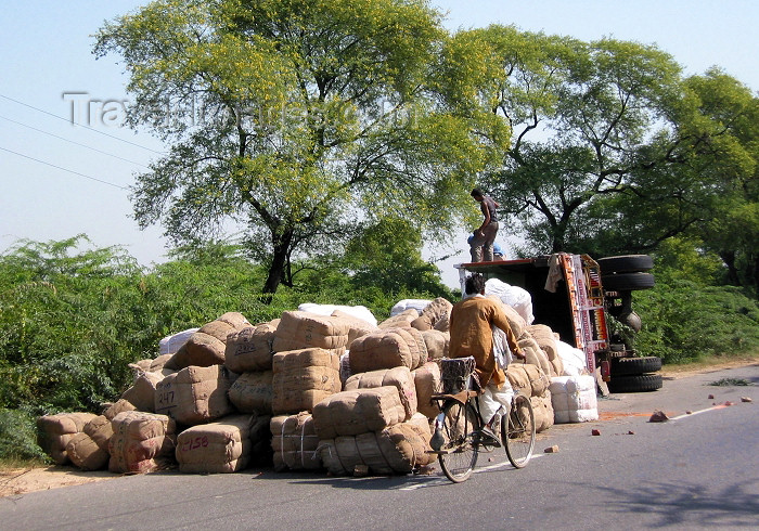 india245: India - Uttar Pradesh: a cyclist passes the scene of a truck accident (photo by J.Kaman) - (c) Travel-Images.com - Stock Photography agency - Image Bank