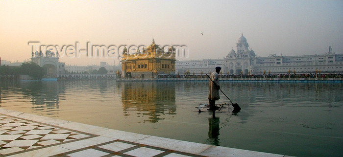 india425: Amritsar, Punjab, India: the Golden temple - man on a raft - photo by J.Cave - (c) Travel-Images.com - Stock Photography agency - Image Bank