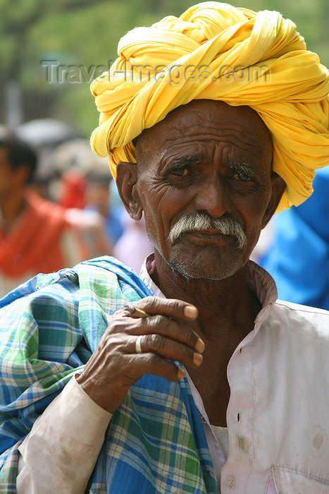 india443: Bundi, Rajasthan, India: old man wearing a yellow turban and smoking - photo by M.Wright - (c) Travel-Images.com - Stock Photography agency - Image Bank