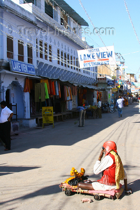 india453: Pushkar, Rajasthan, India: beggar and Lake View hotel - photo by M.Wright - (c) Travel-Images.com - Stock Photography agency - Image Bank