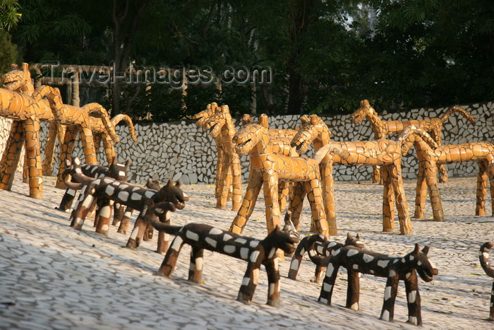 india463: Chandigarh - India: the Rock Gardens - sculptures by Nek Chand Saini - pack of dogs - photo by J.Cave - (c) Travel-Images.com - Stock Photography agency - Image Bank