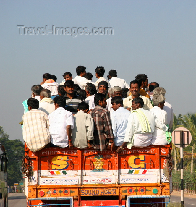india469: Karnataka, India: India Mass transit - passengers densely packed on the back of a truck - photo by J.Cave - (c) Travel-Images.com - Stock Photography agency - Image Bank