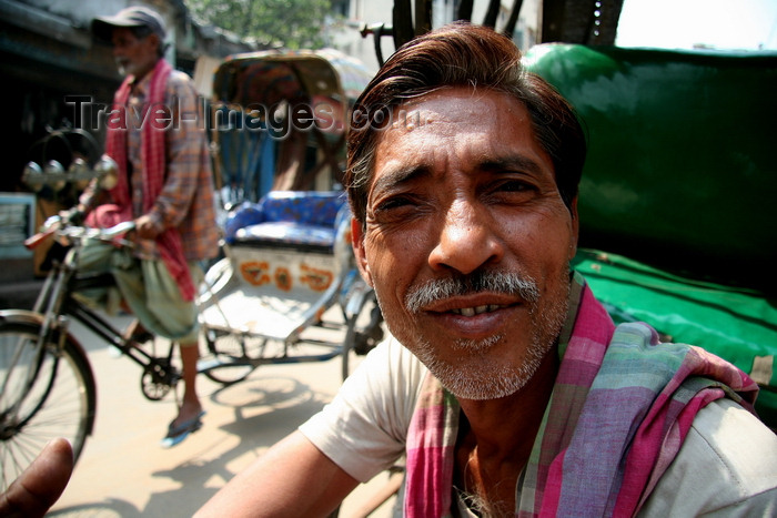 india475: Calcutta / Kolkata, West Bengal, India: face of rickshaw driver waiting for costumers - photo by G.Koelman - (c) Travel-Images.com - Stock Photography agency - Image Bank