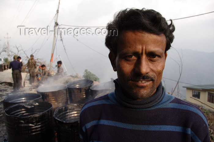 india480: Darjeeling, West Bengal, India: roadworker and tar drums - photo by G.Koelman - (c) Travel-Images.com - Stock Photography agency - Image Bank