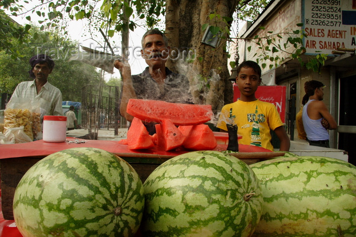 india492: New Delhi, India: watermelon vendor - fruit and burning incense - street life in the Old city - photo by G.Koelman - (c) Travel-Images.com - Stock Photography agency - Image Bank