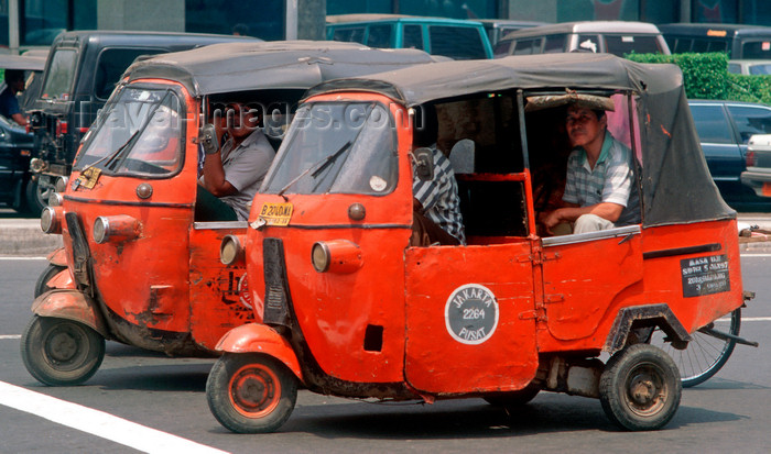 indonesia22: Jakarta, Indonesia - Jakarta city center - Tuk Tuk taxis - photo by B.Henry - (c) Travel-Images.com - Stock Photography agency - Image Bank