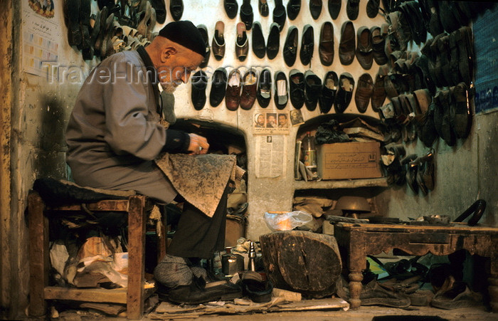 iran133: Iran - Yazd: shoemaker at work in the bazaar - cobbler - photo by W.Allgower - (c) Travel-Images.com - Stock Photography agency - Image Bank