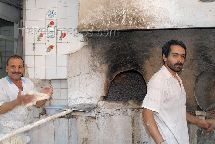 iran154: Iran - Shiraz: bakers at work - bakery ovens - photo by M.Torres - (c) Travel-Images.com - Stock Photography agency - Image Bank