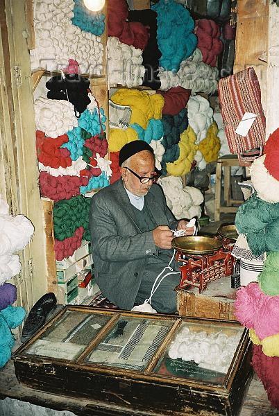 iran2: Iran - Isfahan: man in a wool shop - bazaar - photo by J.Kaman - (c) Travel-Images.com - Stock Photography agency - Image Bank