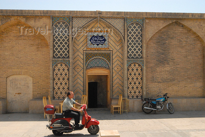 iran211: Iran - Shiraz: scooter passing by the Vakil baths, now a restaurant - photo by M.Torres - (c) Travel-Images.com - Stock Photography agency - Image Bank
