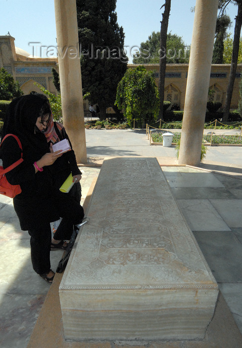 iran223: Iran - Shiraz: Mausoleum of Hafez - a woman read as poem by the Hafez's alabaster tombstone - photo by M.Torres - (c) Travel-Images.com - Stock Photography agency - Image Bank