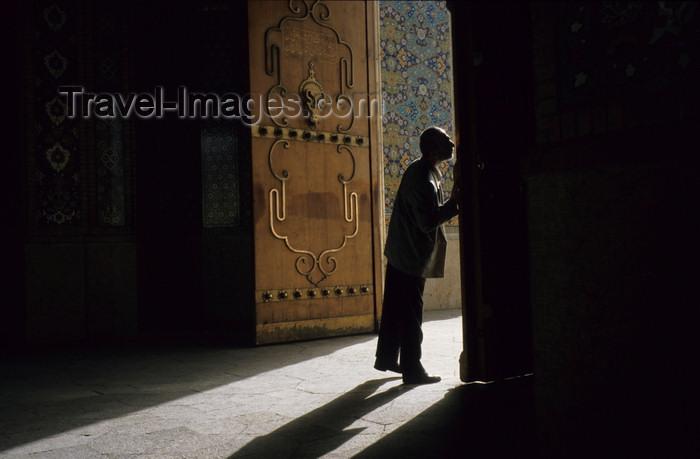 iran241: Iran - Shiraz: Shah-e-Cheragh mausoleum - man kissing the door - photo by W.Allgower - (c) Travel-Images.com - Stock Photography agency - Image Bank