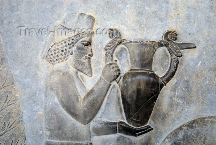 iran293: Iran - Persepolis:  Apadana - Eastern stairs - northern wall - relief showing tribute bearers - an Armenian man carries a present for the Darius the Great - a beautiful metal vessel with griffin (homa) handles - photo by M.Torres - (c) Travel-Images.com - Stock Photography agency - Image Bank