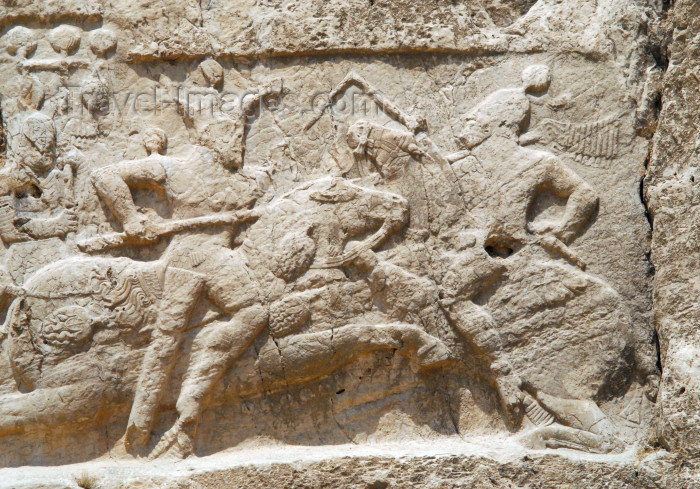 iran336: Iran - Naqsh-e Rustam: Equestrian relief of Bahram II, below tomb of Darius II Nothus - His enemy wears a Roman helmet and may be an emperor - photo by M.Torres - (c) Travel-Images.com - Stock Photography agency - Image Bank