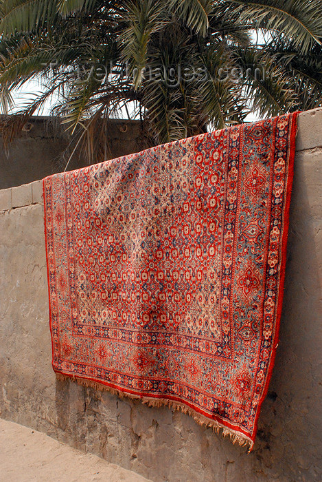 iran346: Iran - Hormuz island: Persian carpet on a wall - photo by M.Torres - (c) Travel-Images.com - Stock Photography agency - Image Bank