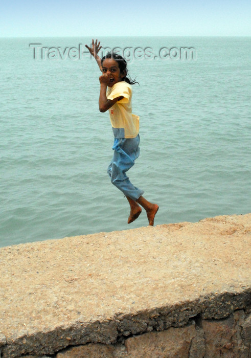 iran370: Iran - Hormuz island: a girl jumps into the Persian gulf - photo by M.Torres - (c) Travel-Images.com - Stock Photography agency - Image Bank