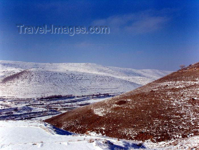 iran504: Kandovan, Osku - East Azerbaijan, Iran: snow on the slopes of the Sahand Mountains - photo by N.Mahmudova - (c) Travel-Images.com - Stock Photography agency - Image Bank