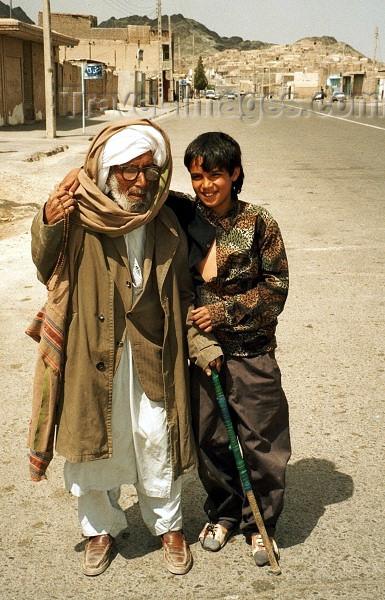 iran52: Iran - Zahedan (Baluchistan / Sistan va Baluchestan): support - boy helping an elderly gentleman - photo by J.Kaman - (c) Travel-Images.com - Stock Photography agency - Image Bank