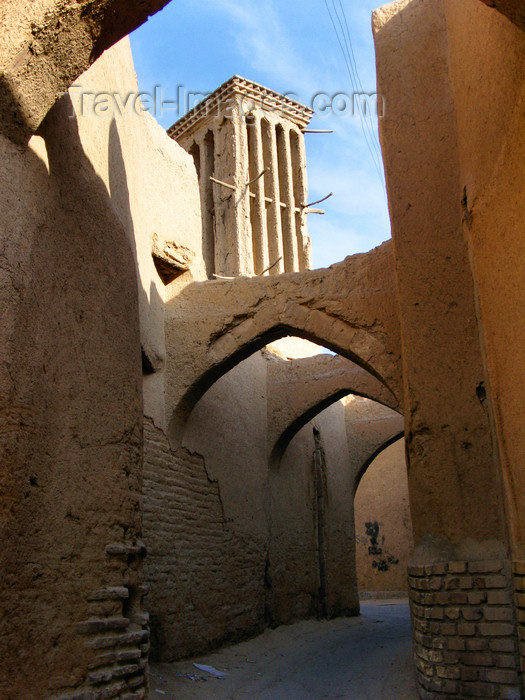 iran548: Yazd, Iran: a quintessential alley of Yazd, with pointed arches and a wind catcher - old town - photo by N.Mahmudova - (c) Travel-Images.com - Stock Photography agency - Image Bank