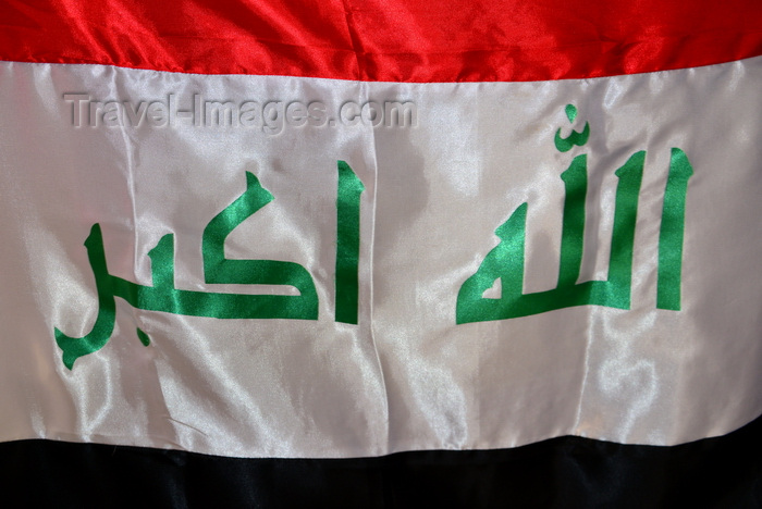 """iraq69: Iraq: flag of Iraq - arabic inscription in green """"God is Great"""", the Takbir or Tekbir,  Allahu Akbar - horizontal red, white, and black stripes of the Arab Liberation Flag - (c) Travel-Images.com - Stock Photography agency - Image Bank"""