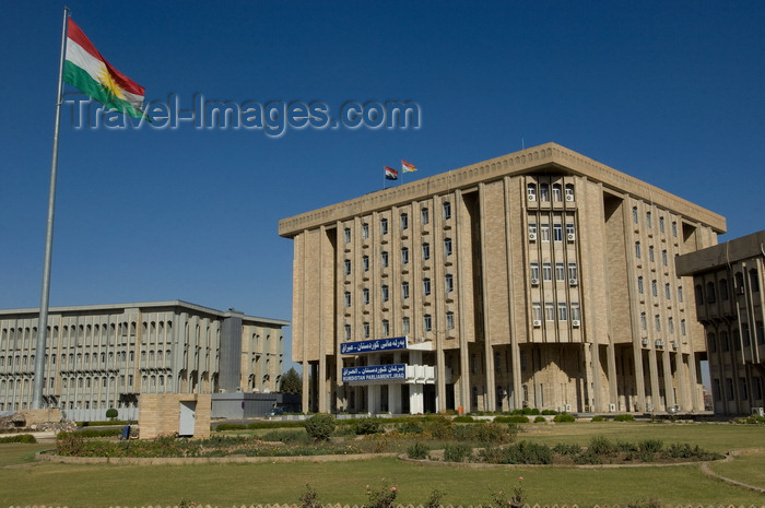 iraq89: Arbil / Erbil / Irbil / Hawler, Kurdistan, Iraq: Kudish flag flying in front of the Kurdish Parliament - photo by J.Wreford - (c) Travel-Images.com - Stock Photography agency - Image Bank