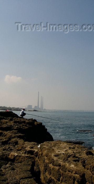 israel124: Israel - Qesarriya / Caesarea Maritima / Caesarea Palaestina - Hadera: angler and the Orot Rabin power station - photo by Efi Keren - (c) Travel-Images.com - Stock Photography agency - Image Bank