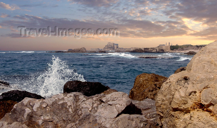 israel127: Israel - Qesarriya / Caesarea Maritima / Caesarea Palaestina: rocks, the bay and the old city - photo by Efi Keren - (c) Travel-Images.com - Stock Photography agency - Image Bank