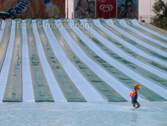 israel256: Israel - Shfaim: water park - child alone by the water chutes - blue lines - photo by E.Keren - (c) Travel-Images.com - Stock Photography agency - Image Bank