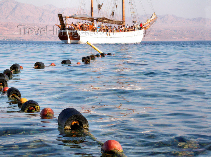 israel372: Eilat, South district, Israel: rope with floats on Red sea surface and the yacht L'Amie - Mifratz Eilat - photo by E.Keren - (c) Travel-Images.com - Stock Photography agency - Image Bank