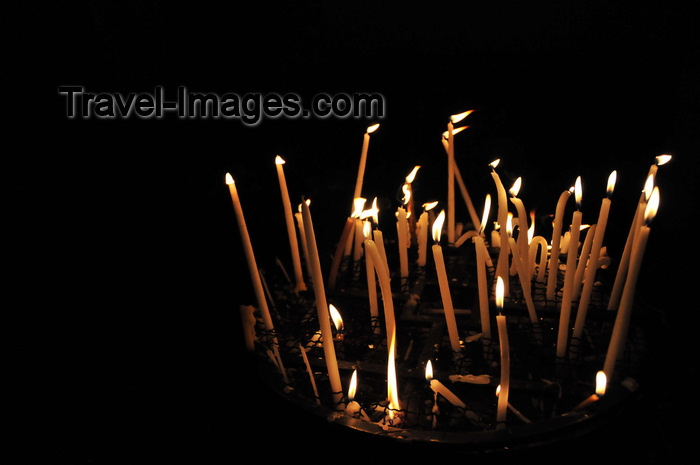 israel441: Jerusalem, Israel: candles placed by the faithful burn brightly inside the Holy Sepulcher church - Christian quarter - photo by M.Torres - (c) Travel-Images.com - Stock Photography agency - Image Bank
