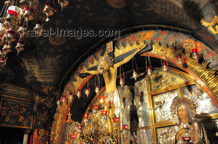 israel444: Jerusalem, Israel: Holy Sepulcher church - Calvary (Golgotha), traditionally regarded as the site of Jesus' crucifixion - main altar, run by the Greek Orthodox, which contains The Rock of Calvary, 12th Station of the Cross - Christian quarter - photo by M.Torres - (c) Travel-Images.com - Stock Photography agency - Image Bank
