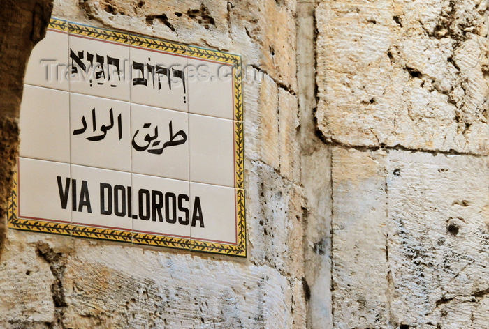israel450: Jerusalem, Israel: street sign on Via Dolorosa, the holy path Jesus walked on his final day - sign in Hebrew, Arabic and Latin, tiles over stone ashlars - photo by M.Torres - (c) Travel-Images.com - Stock Photography agency - Image Bank