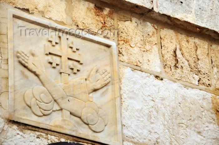israel453: Jerusalem, Israel: Via Dolorosa, Station 5, carving of Franciscan arms with Jerusalem cross - Fransciscan Order symbol - photo by M.Torres - (c) Travel-Images.com - Stock Photography agency - Image Bank