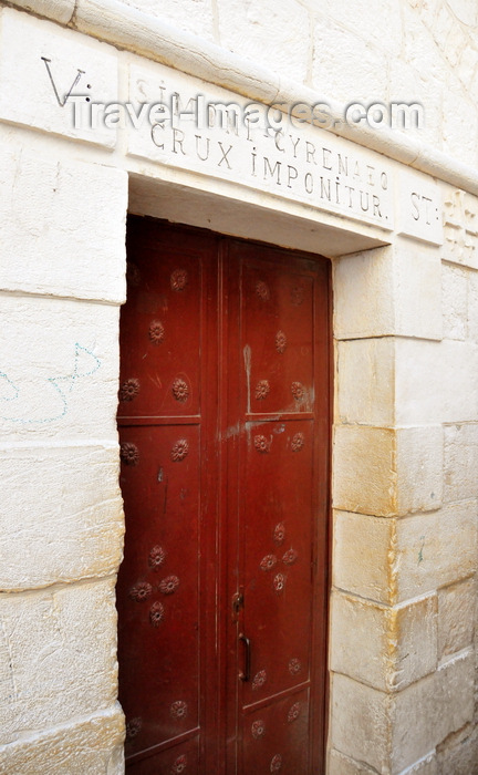 israel455: Jerusalem, Israel: Via Dolorosa, 5th station, door of the Franciscan  church dedicated to Simon the Cyrenian, who took  Jesus' cross, and carried it for him - photo by M.Torres - (c) Travel-Images.com - Stock Photography agency - Image Bank